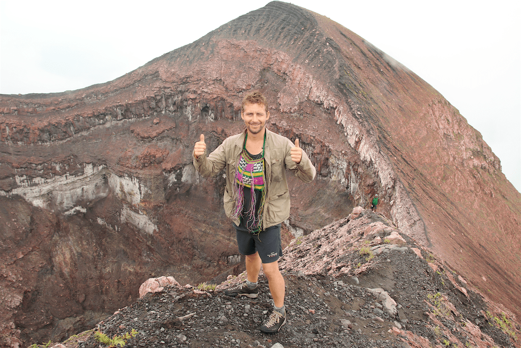 Thor at crater of the active volcano on Bam island.
